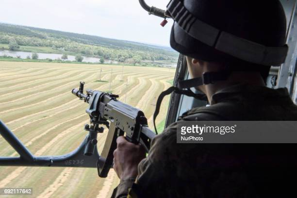 A Ukrainian serviceman in a military helicopter Donetsk region Ukraine June 1 2017