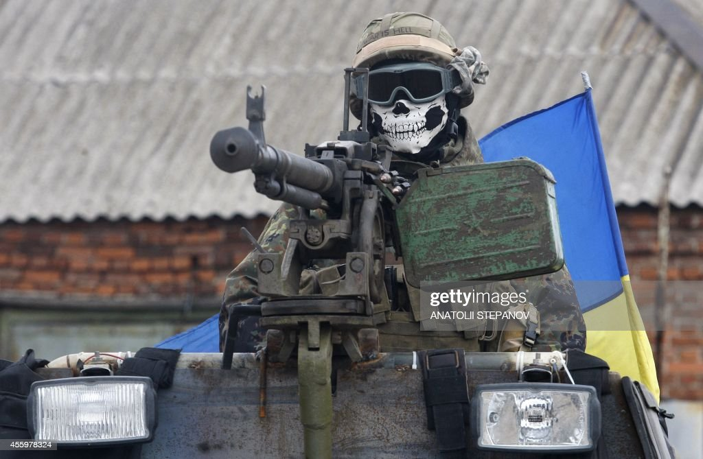 A Ukrainian serviceman wears a mask depicting a skull on September 23 2014 on armored personnel carrier in a suburb of the eastern town Debaltseve in...
