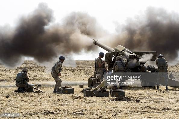 Ukrainian servicemen fire with howitzer during a military exercise near eastern the Ukrainian city of Mariupol on September 22 2015 NATO's General...