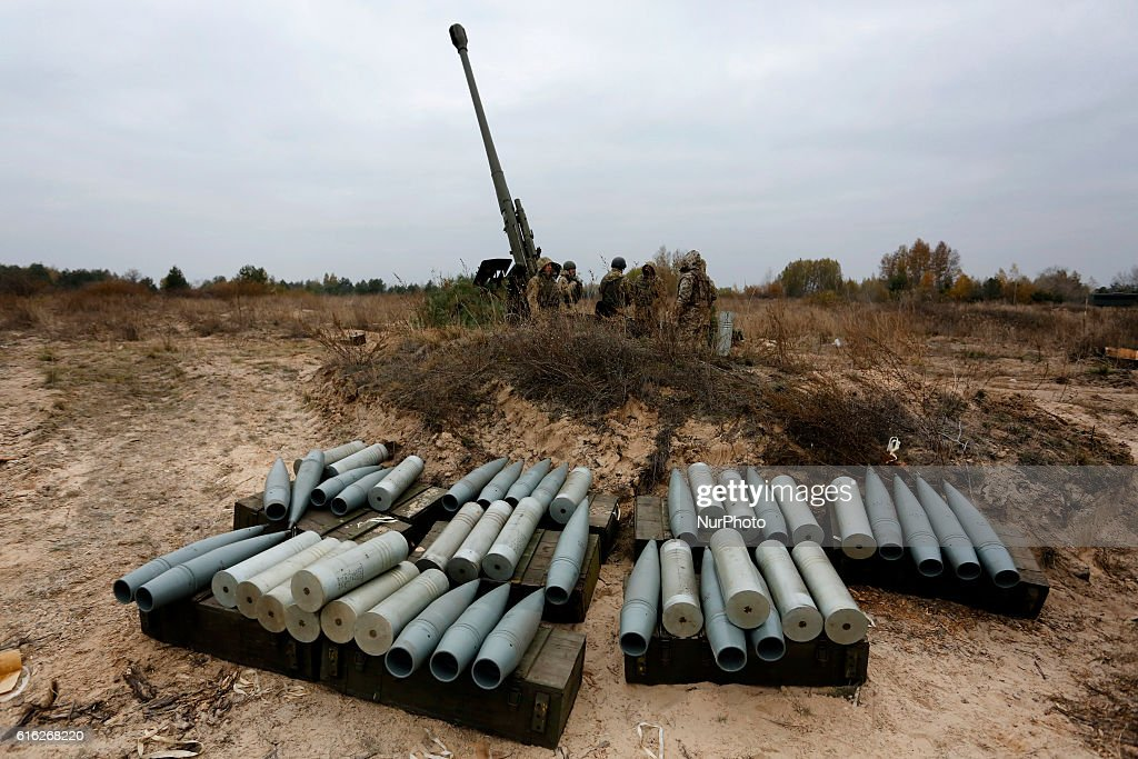 Ukrainian servicemen operate with shells as they fire a 152mm 'Msta B' howitzer during military exercises near the village of Divychky in Kyiv region, Ukraine, October 21, 2016.