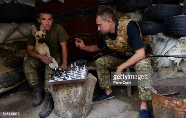 Ukrainian servicemen play chess on the frontline on September 06 2017 in Avdiivka Ukraine The frontlinecity Avdiivka is located on the outskirsts of...