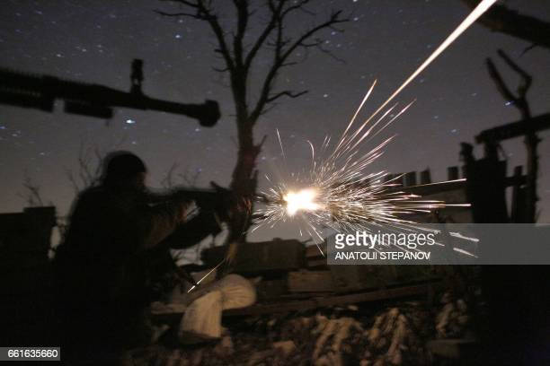 TOPSHOT Ukrainian servicemen shot with machine guns during fighting with proRussian separatists in Avdiivka Donetsk region on March 31 2017 US...