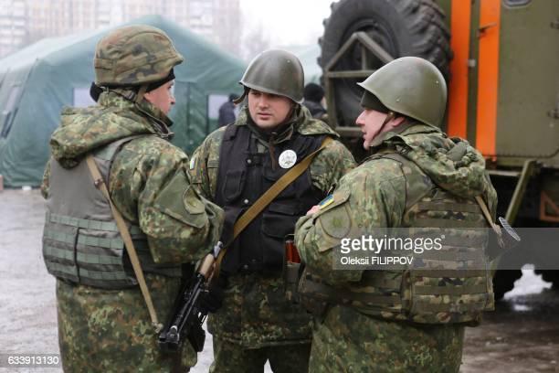 Ukrainian servicemen talk in the streets of Avdiivka Donetsk region on February 5 3017 Fighting subsided around a flashpoint Ukrainian town on...
