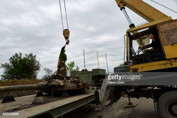 Ukrainian servicemen unload the turret of a tank to build a monument for fallen Ukrainian soldiers on September 06 2017 in Avdiivka Ukraine The...