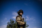 A Ukrainian soldier stands guard at a checkpoint on a road near the city of Dnepropetrovsk on August 25 2014 Kiev said its forces clashed with an...