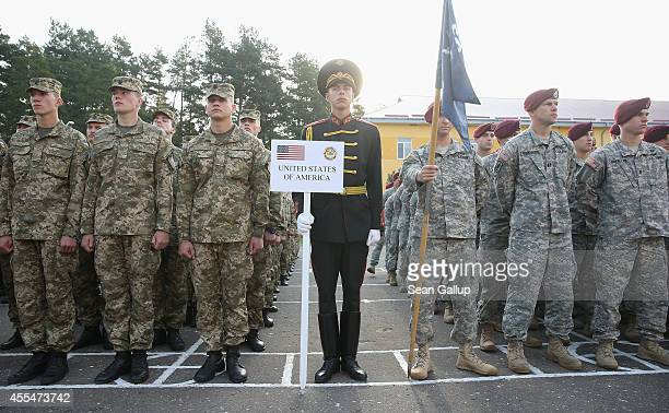 "Ukrainian soldiers and members of the US Army 173rd Airborne Brigade arrive for the opening ceremony of the ""Rapid Trident"" bilateral military..."