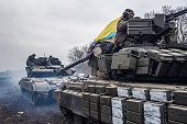 Ukrainian soldiers drive tanks along the road leading out of Debaltseve on February 19 2015 in Artemivsk Ukraine Ukrainian forces have begun...