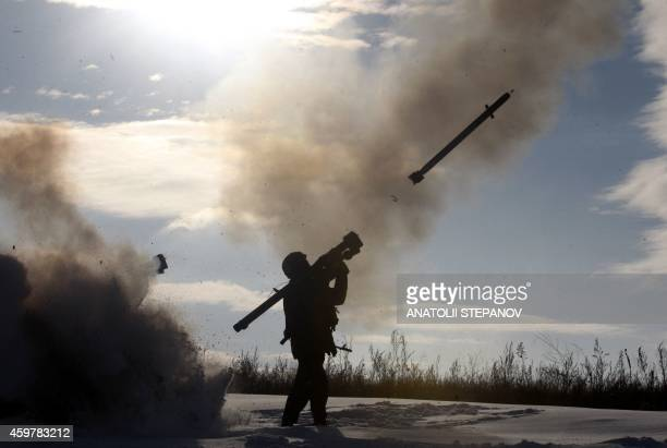 A Ukrainian soldiers fires a missile with a manportable airdefense system during exercices near the city of Shchastya north of Lugansk on December 1...