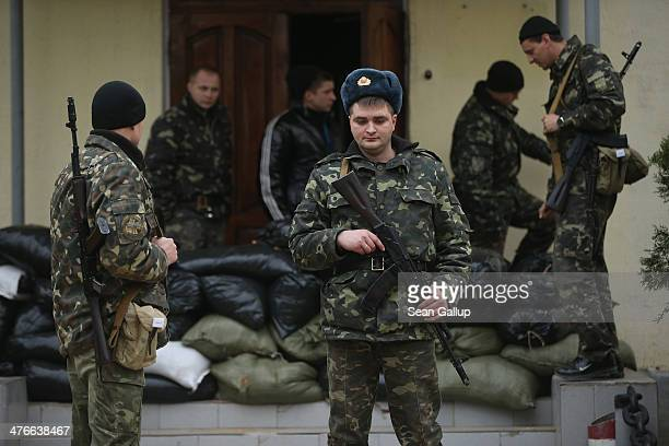 Ukrainian soldiers inside the Belbek military base emerge from their barracks behind sandbags in the early morning following a tense night on March 4...