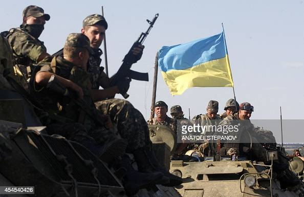 Ukrainian soldiers sit on top of an APC in a column of Ukrainian tanks which travels in Donetsk region on September 3 2014 Beleaguered Ukrainian...