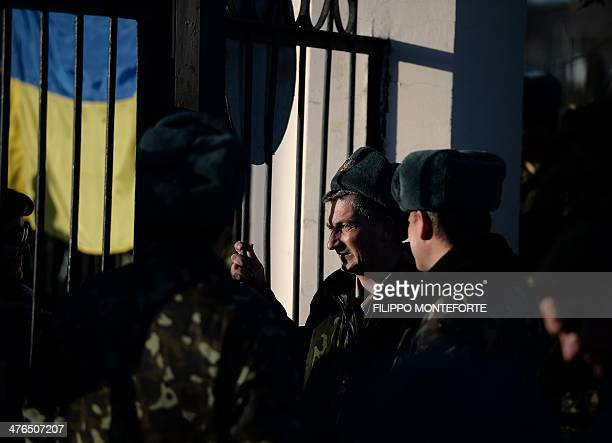 Ukrainian soldiers wait inside the Sevastopol tactical military brigade base in Sevastopol on March 3 2014 Russian forces have given Ukrainian...