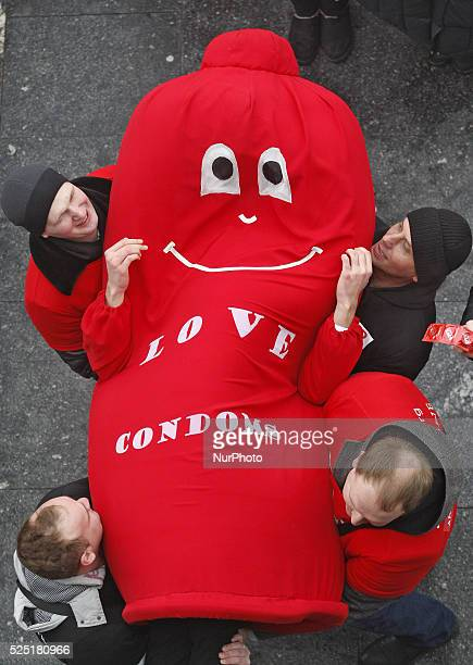 Ukrainian students and volunteers and man dressed in a Condom suit during a flashmob called quotProtect your lovequotas they mark the International...