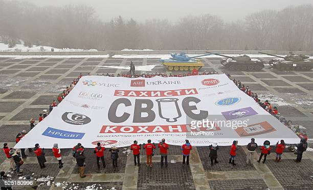 Ukrainian students and volunteers hold banner with slogan 'Wrap your love' during a flashmob called quotProtect your lovequotas they mark the...