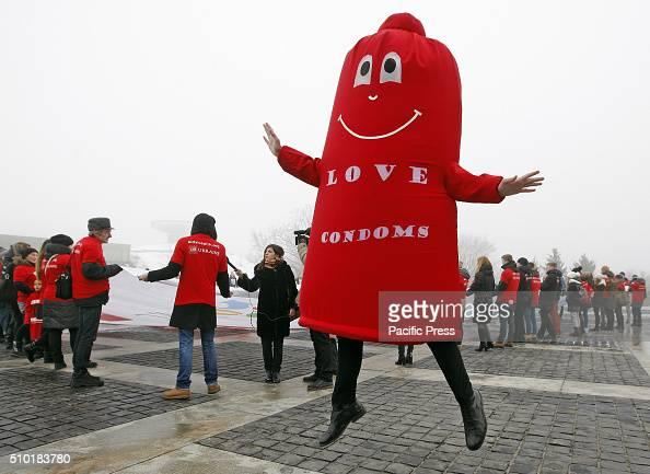 Ukrainian studentsvolunteers and a man dressed in a Condom suit during a flash mob called 'Wrap your love' as they mark the International Condom Day...