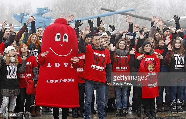 Ukrainian studentsvolunteers and man dressed in a Condom suit during a flash mob called 'Wrap your love' as they mark the International Condom Day at...
