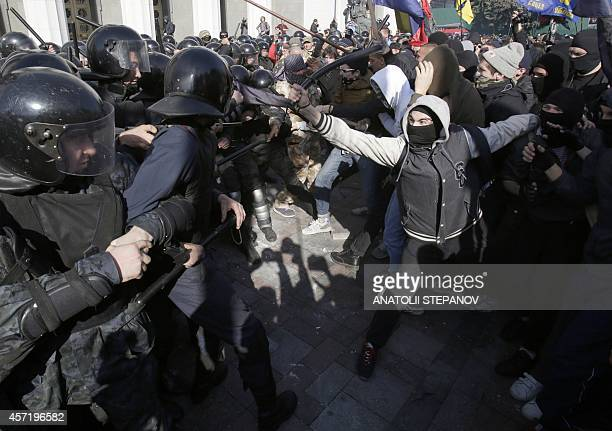 Ukrainian supporters and activists of farright parties and nationalist movements clash with riot police outside the Ukrainian parliament in Kiev on...