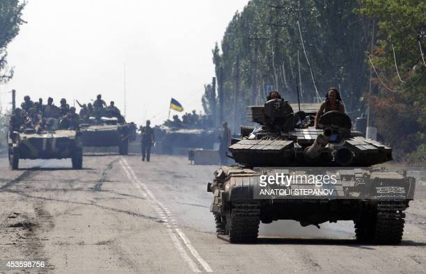 Ukrainian tanks pass by the small eastern Ukrainian city of Vuglegirsk Donetsk region on August 14 freed by the country's forces three days ago...