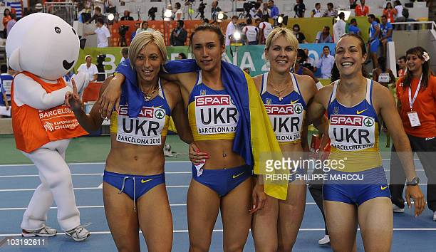 Ukrainian team poses as it celebrates its victory in the women's 4x100m relay final under the look of B10 mascot Barni at the 2010 European Athletics...