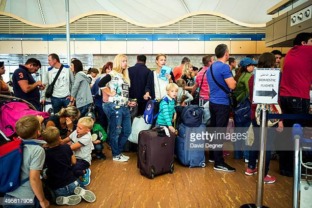 Ukrainian tourists wait to check in for their flight on November 5 2015 in Sharm ElSheikh Egypt British flights going to and from Egyptian resort of...
