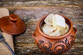 Ukrainian traditional food pelmeni or meat dumplings served on the rustic wood table