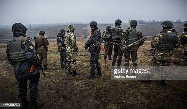Ukrainian troops from Donbass battalion train with small arms on March 13 2015 outside Mariupol Ukraine The Minsk ll ceasefire agreement which has...