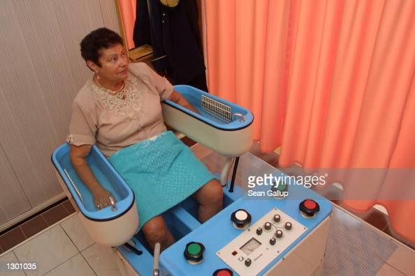 Ukrainian visitor Luba Sher undergoes a mineral water and light electric shock therapy to relax her muscles and improve blood circulation August 7...