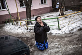 A Ukrainian woman begs Ukrainian President Petro Poroshenko to stop the bombing in Donetsk after shell hit the residential area where she lives...