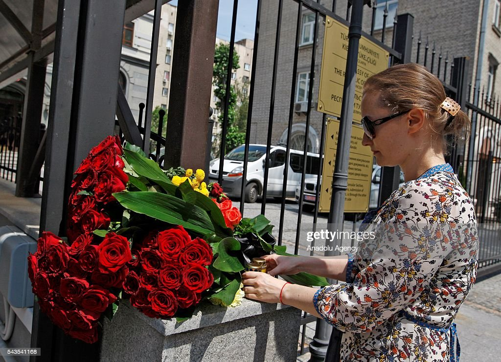 Ukrainian woman lays flowers for the victims of the terror attack at Istanbul Ataturk International Airport near the Turkish Embassy in Kiev, Ukraine on June 29, 2016. At least 41 victims and three suicide bombers were killed while scores of others were injured in a terror attack at Istanbul's Ataturk International Airport.
