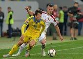 Ukrainian Yevhen Konoplyanka vies with Belarusian Igor Shitov during their Euro 2016 Group C football match between Ukraine and Belarus at Arena Lviv...