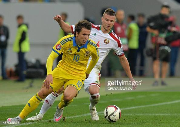 Ukrainian Yevhen Konoplyanka vies with Belarusian Igor Shitov during their Euro 2016 Group C football match between Ukraine and Belarus at Arena Lviv...