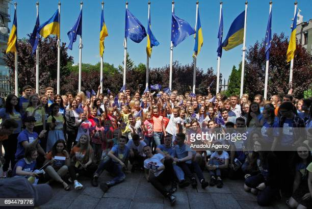 Ukrainian youth pose for a photo as they take part in the ceremony of start to a symbolic 'visafree timer' at the President Administration in Kiev...