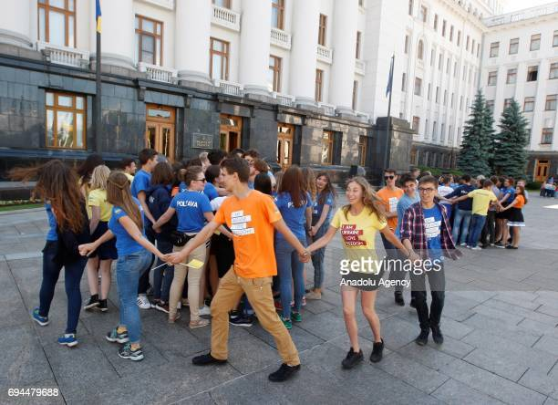 Ukrainian youth take part in the performance during a ceremony of start to a symbolic 'visafree timer' at the President Administration in Kiev...