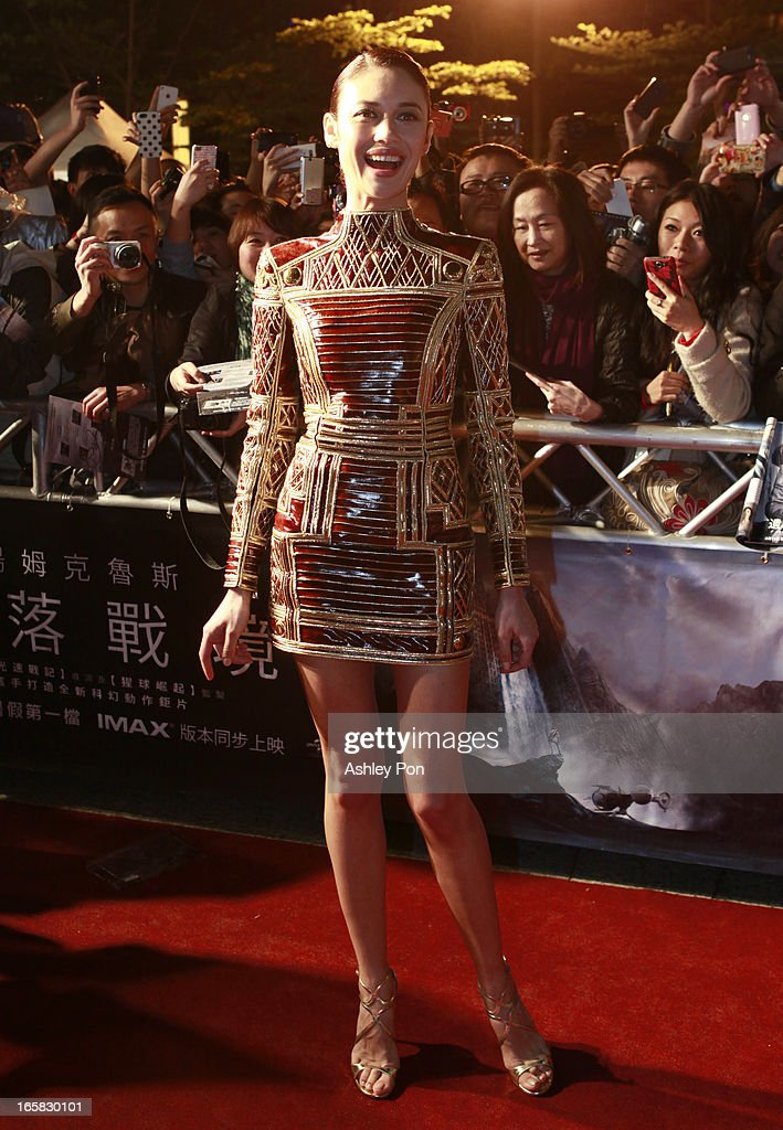 Ukrainian-born actress and model Olga Kurylenko poses for a photograph as she arrives at the Taiwan premiere of 'Oblivion' on April 6, 2013 in Taipei, Taiwan.