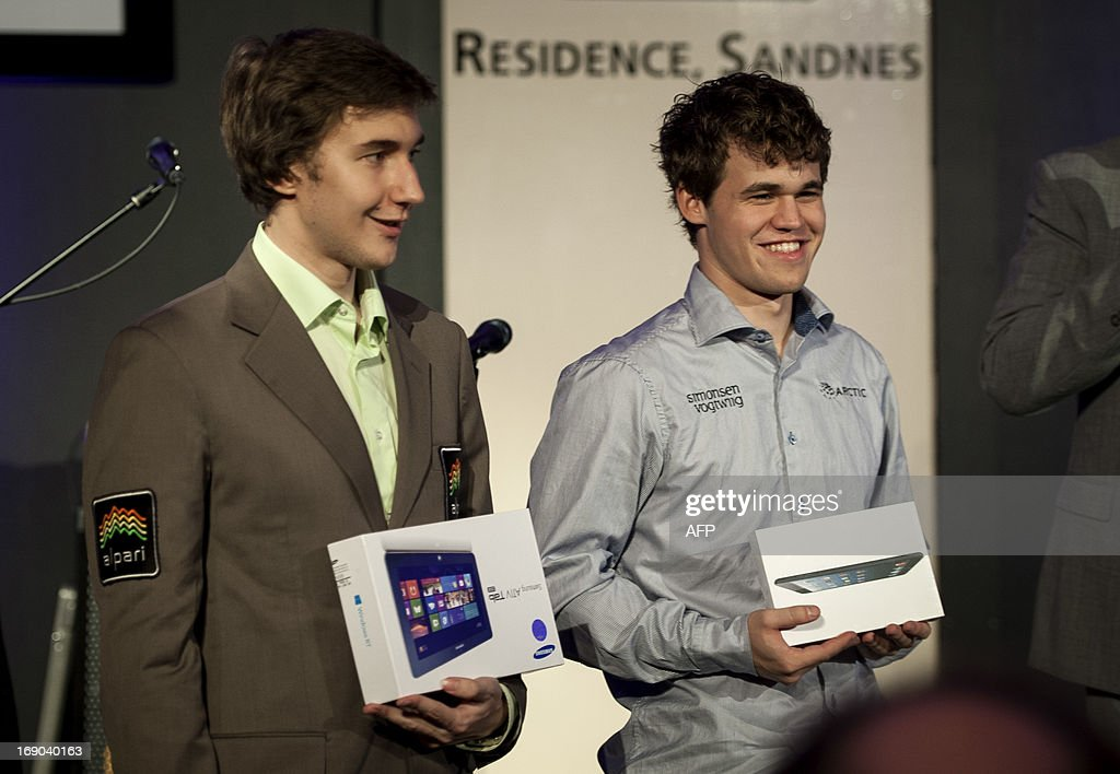 Ukrainian-born Russian chess grandmaster Sergey Karjakin (L, 1st) and Norwegian grandmaster Magnus Carlsen (2nd) pose after the Norway Chess tournament in Stavanger on May 18, 2013. AFP PHOTO / CARINA JOHANSEN / NTB SCANPIX NORWAY / NORWAY OUT