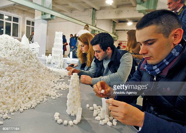Ukrainians create structures of sugar as interactive sculpture installations from sugar called 'Sugar democracy' built by Irish artists Brendan...