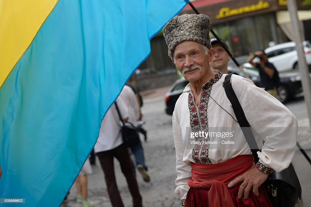 Ukrainians dressed in vyshyvankas with traditional embroideries attend the 'March in vyshyvankas' in downtown Kyiv on 28 May 2016 in Kiev, Ukraine. Vyshyvanka is the Slavic traditional clothing which contains elements of Ukrainian ethnic embroidery. The attire is becoming very popular now in the Ukraine, as it is considered fashionable for all Ukrainians and patriots.