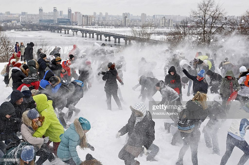 Ukrainians throw snowballs at each other during mass event called 'The Snow battle-2016' at the park of the Great Patriotic War, in Kiev, Ukraine on January 17, 2016. After a relatively warm weather in Kiev again came a cold.