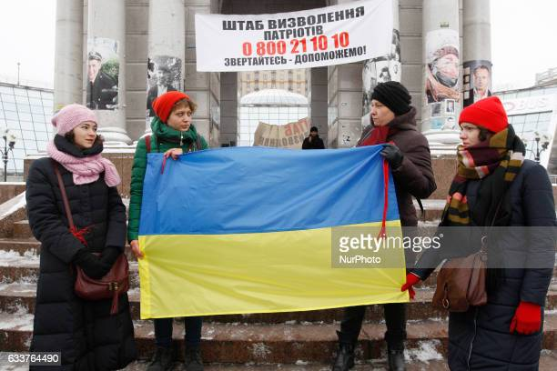 Ukrainians with red ribbons attend a rally called quotSave Avdiivkaquot in support of Avdiivka inhabitants on Independence Square in Kiev Ukraine 04...
