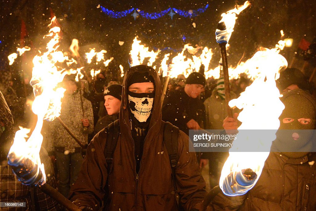 UkrainIian nationalists, carrying torches, march in the western Ukrainian city of Lviv late on January 29, 2013 marking the 95th anniversary of a battle near the small city of Kruty. 300 students, cadets and schoolboys were killed, during a combat against the regular Red Army on 29 January, 1918, to protect the new-born Ukraine's People Republic against Bolshevik aggression.