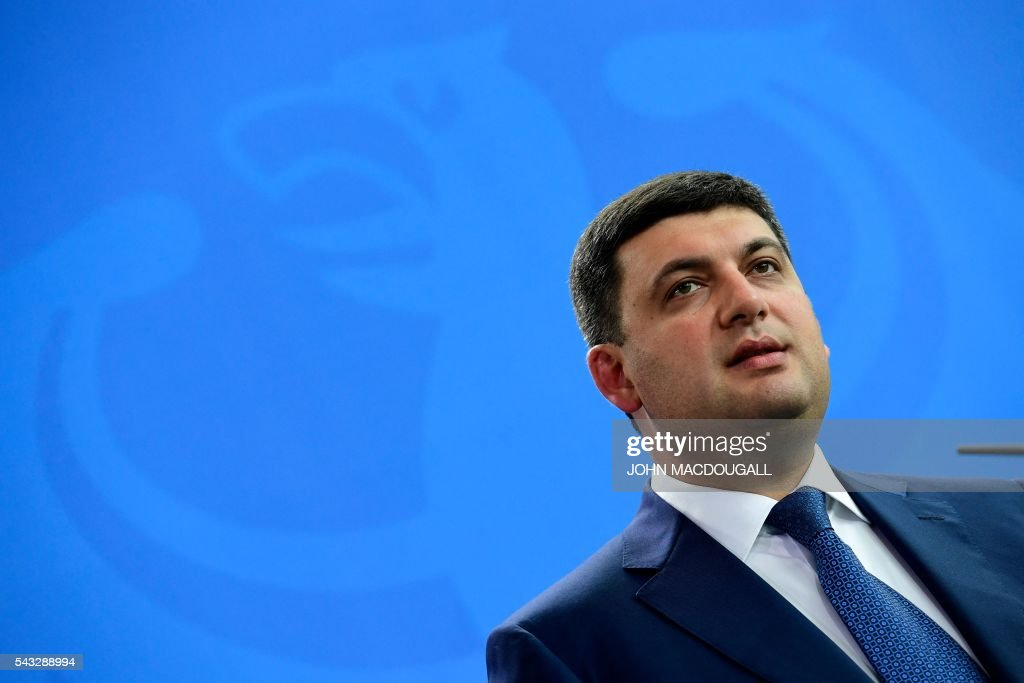Ukraininian Prime Minister Volodymyr Groysman addresses a joint press conference with the German chancellor after talks at the chancellery in Berlin on June 27, 2016. / AFP / John MACDOUGALL