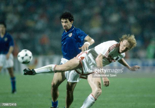 Ukranian footballer Oleh Kuznetsov beats Italian player Gianluca Vialli for the ball for the Soviet Union team to beat Italy 20 in the semi finals of...