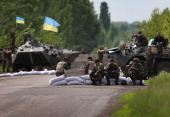 Ukranian military soldiers man a highway checkpoint on May 13 2014 near Slovyansk Ukraine At least 6 Ukranian soldiers were killed and more were...
