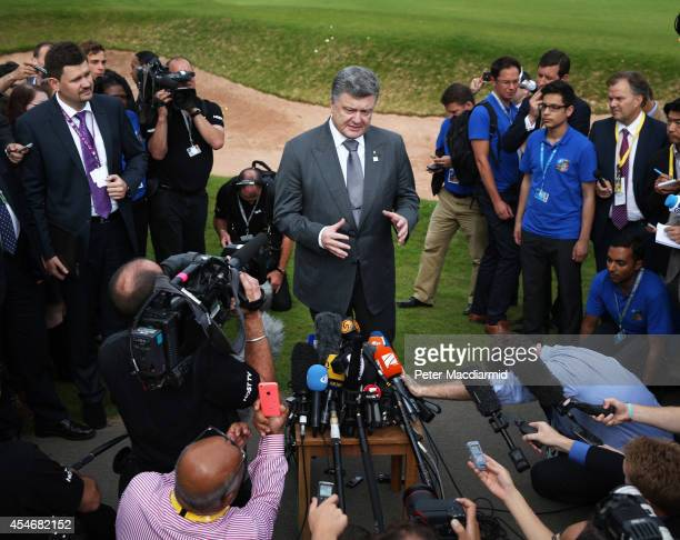 Ukranian President Petro Poroshenko faces reporters on the golf course at the NATO Summit on September 5 2014 in Newport Wales The President...
