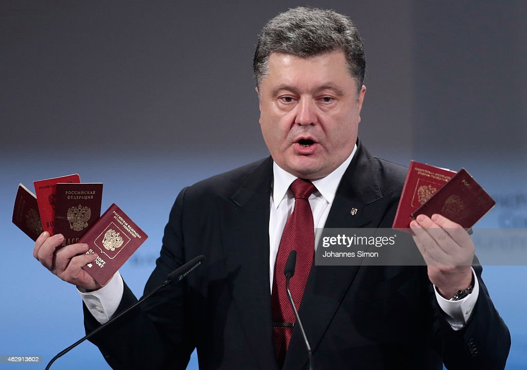 Ukranian President <a gi-track='captionPersonalityLinkClicked' href=/galleries/search?phrase=Petro+Poroshenko&family=editorial&specificpeople=549382 ng-click='$event.stopPropagation()'>Petro Poroshenko</a> holds up Russian passports during a speech at the 51st Munich Security Conference (MSC) on February 7, 2015 in Munich, Germany. Foreign ministers and defense ministers from countries across the globe are meeting to discuss current global security issues, in particular the crisis in eastern Ukraine, the spread of ISIS in Syria and Iraq and the large-scale movement and plight of refugees.