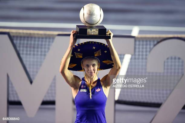Ukranian tennis player Lesia Tsurenko holds up the trophy after winning the Mexican Tennis Open WTA final match against French Kristina Mladenovic in...