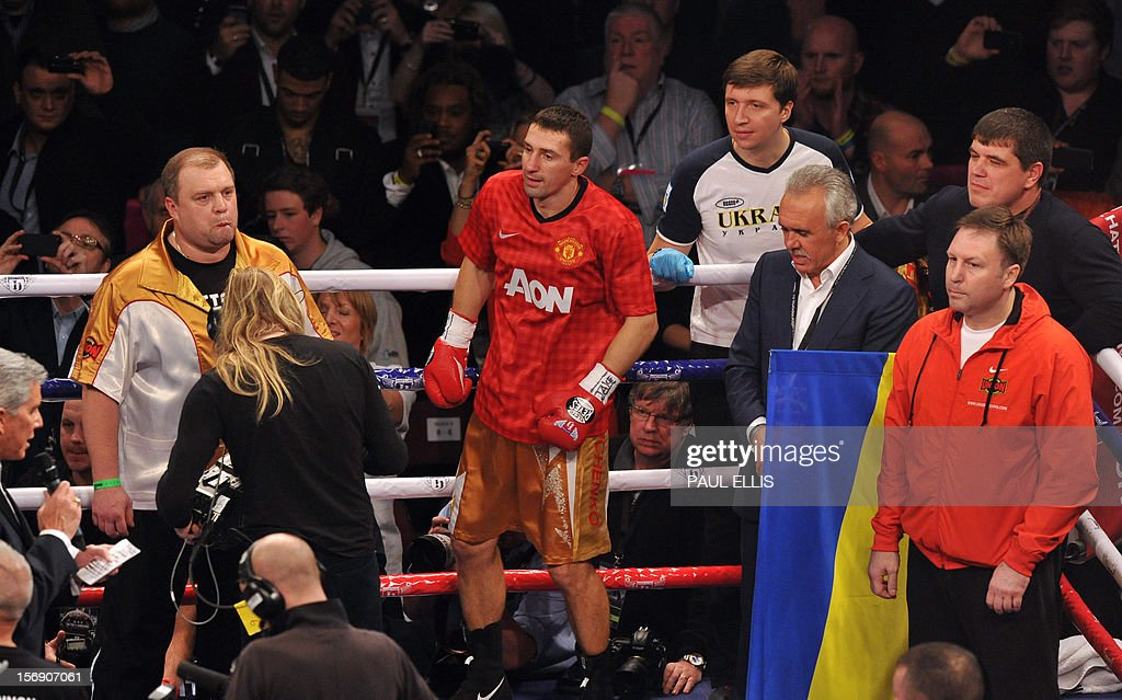 Ukranian Vyacheslav Senchenko arrives wearing a Manchester United football shirt ahead of the welteweight boxing match against Britain's Ricky Hatton at The Manchester Arena in Manchester, north-west England, on November 24, 2012.