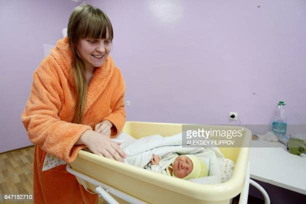 A Ukranian woman named only as Olga plays with her newborn baby at the maternity hospital in the eastern Ukrainian city of Avdiivka on January 16...