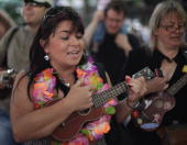 Ukulele players gather for a mass busk in Cheltenham town centre on June 19 2010 in Cheltenham England The town is hosting its first three day...