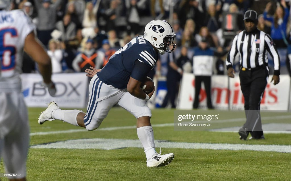 Ula Tolutau #5 of the Brigham Young Cougars scores a touchdown during the first half of play against the Boise State Broncos at LaVell Edwards Stadium on October 6, 2017 in Provo, Utah.