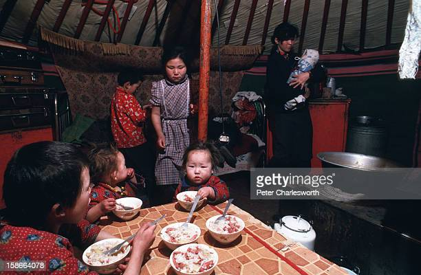 Ulan Bator ULAN BATOR Mongolia A family living inside the family Ger or Yurt on the outskirts of Ulan Bator The mother is tending to her youngest...